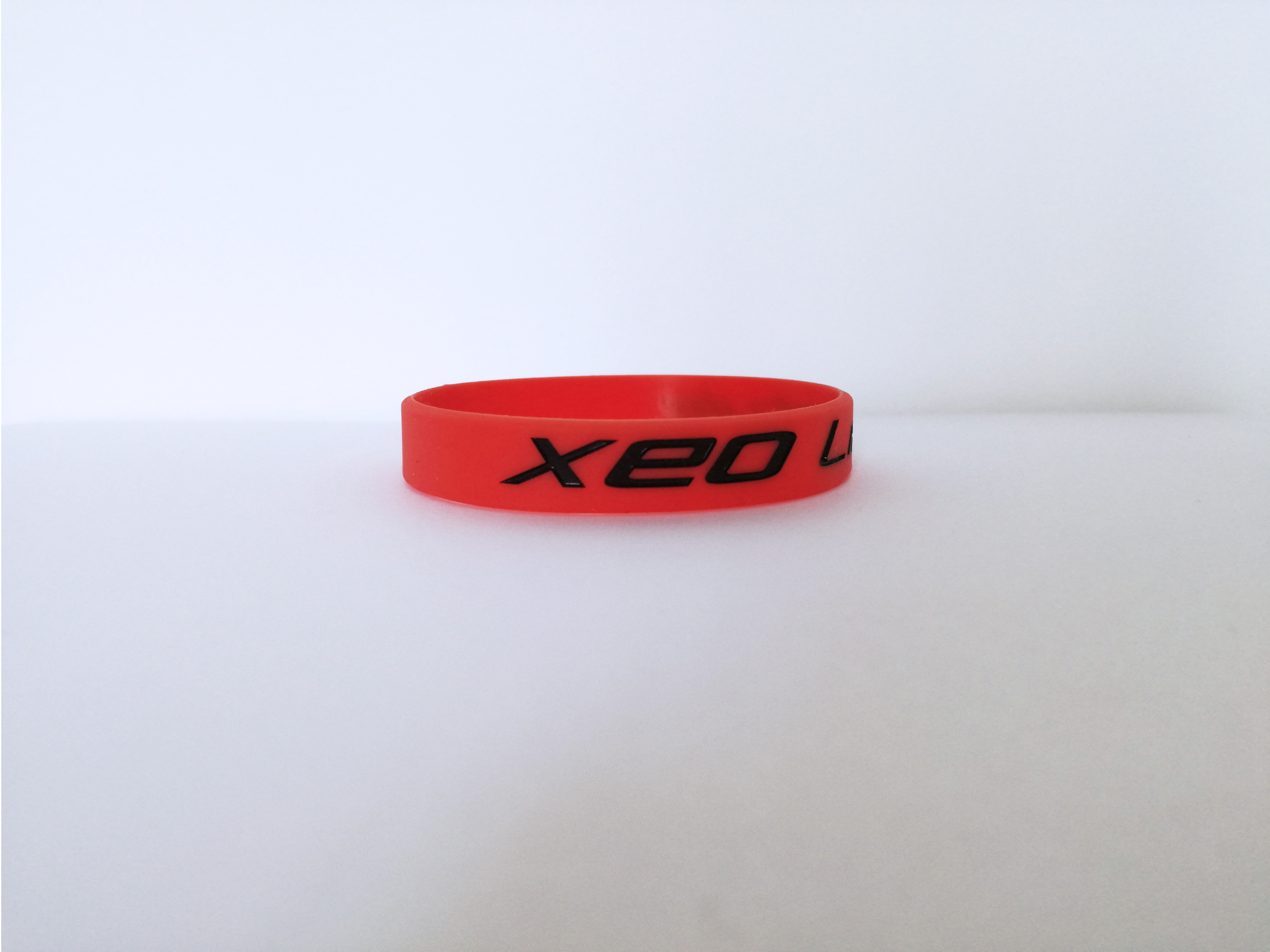 XEO Lifestyle Red Bracelet / Black Text